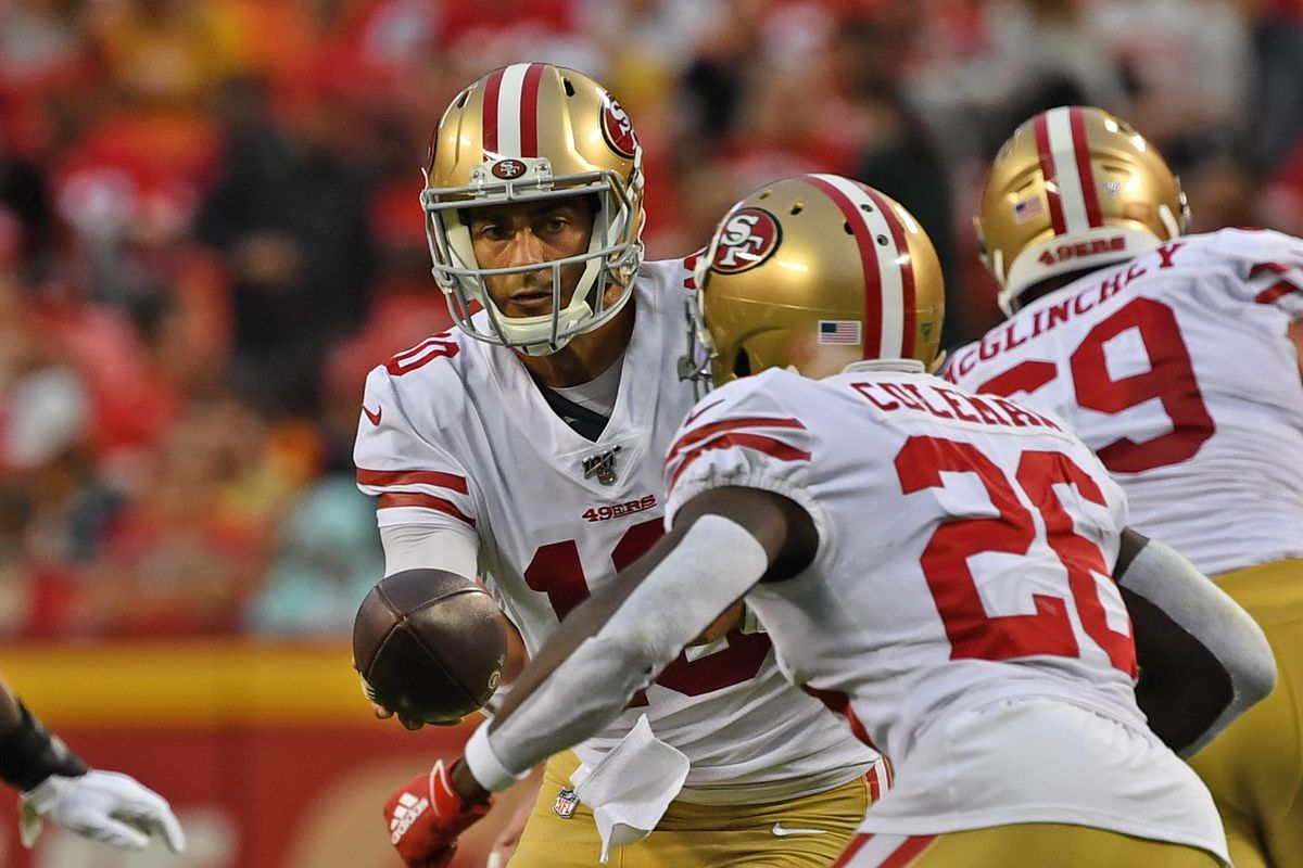 San Francisco 49ers quarterback Jimmy Garoppolo hands the ball off to running back Tevin Coleman during the first half of a pre-season game against the Kansas City Chiefs at Arrowhead Stadium on August 24, 2019 in Kansas City, Missouri.