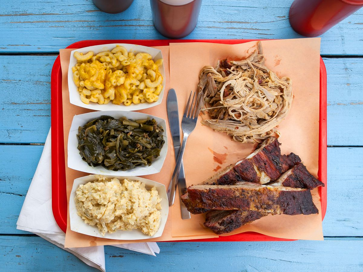 A tray of whole hog barbecue and sides