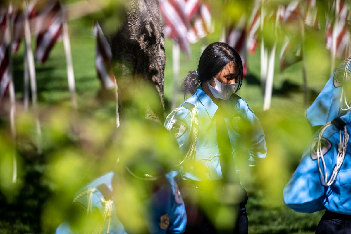 A law enforcement officer bows their head in prayer during the annual Utah Police Memorial Service at the Utah Capitol on Thursday, May 6, 2021. Utah police officers, family, friends and community leaders gathered for the annual service honoring the 147 Utah police officers killed in the line of duty.