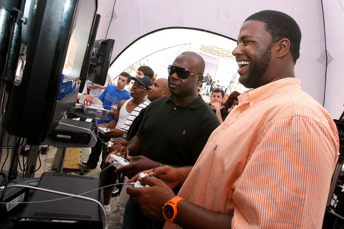 NEW ORLEANS - AUGUST 09:  NFL Legend Marshall Faulk (C) plays as Derby County on FIFA 11. You might have to go to Wikipedia to figure that joke out.  (Photo by Sean Gardner/Getty Images)
