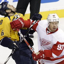 Detroit Red Wings right wing Johan Franzen (93), of Sweden, collides with Nashville Predators defenseman Shea Weber (6) in the first period of Game 1 of a first-round NHL hockey playoff series on Wednesday, April 11, 2012, in Nashville, Tenn. Franzen was called for roughing on the play.