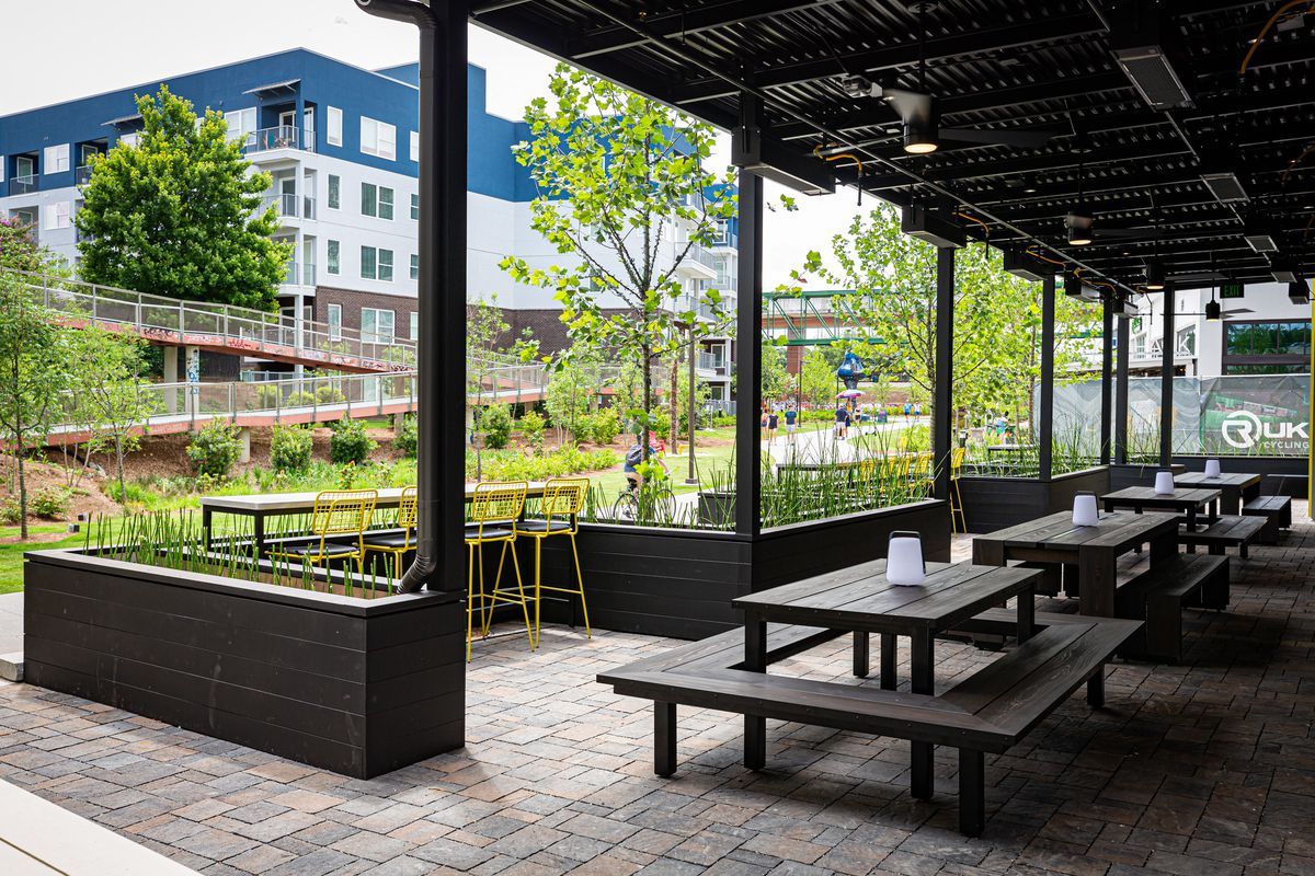 A view of the empty patio on the ground level of Cold Beer on the Atlanta Beltline