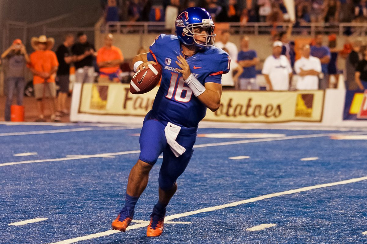 Joe Southwick #16 of the Boise State Broncos looks for a receiver against the Tulsa Golden Hurricane at Bronco Stadium in Boise, Idaho.  (Photo by Otto Kitsinger III/Getty Images)