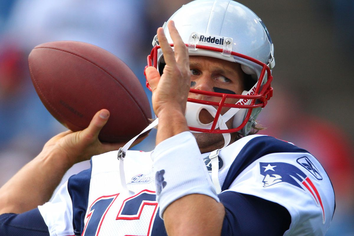 ORCHARD PARK, NY - SEPTEMBER 25: Tom Brady #12 of the New England Patriots warms up before their NFL game against the Buffalo Bills at Ralph Wilson Stadium on September 25, 2011 in Orchard Park, New York. (Photo by Tom Szczerbowski/Getty Images)