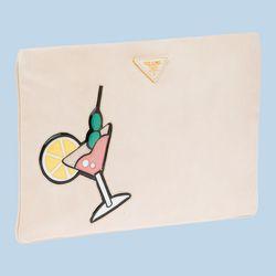 "<b>Prada</b> Nappa Leather clutch, <a href=""http://store.prada.com/en/US/woman/handbags/clutches-and-evening/BP521K_2ATN_F0507"">$895</a>"