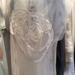 Mesh tunic with crochet embroidery, $80