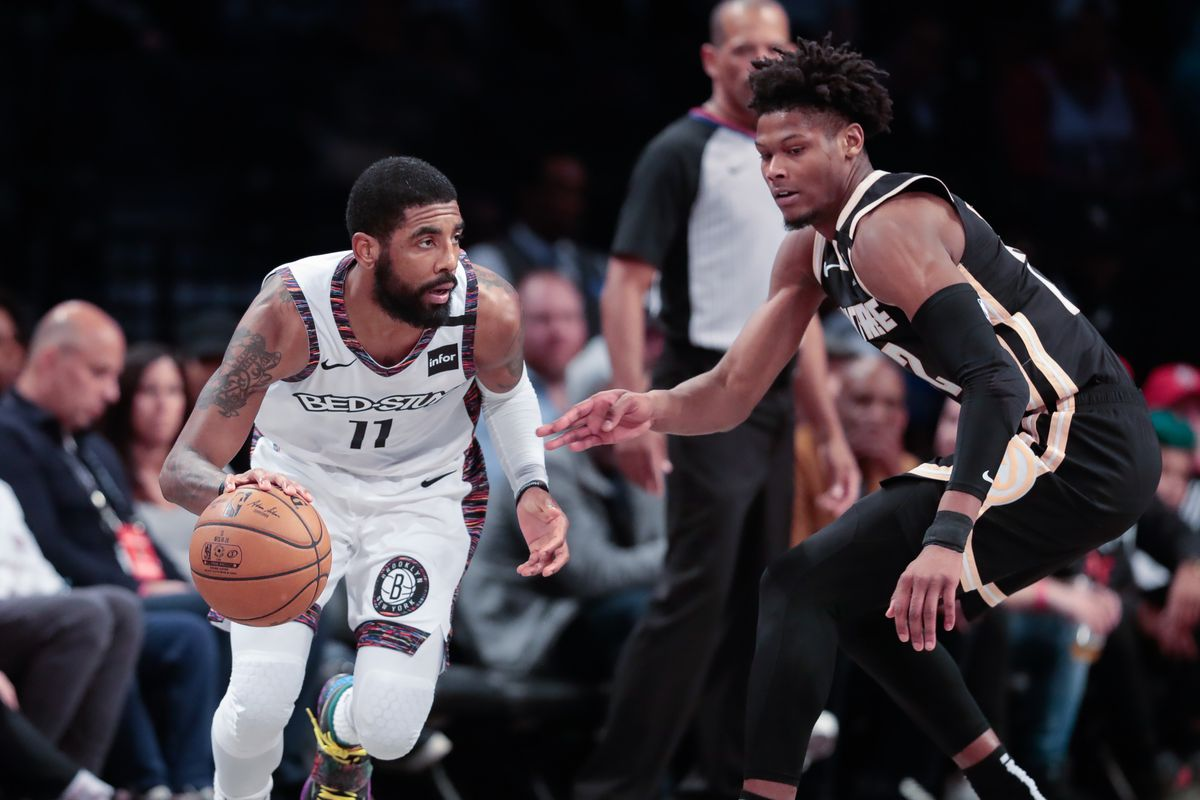 Brooklyn Nets guard Kyrie Irving dribbles as Atlanta Hawks forward Cam Reddish defends during the second quarter at Barclays Center.