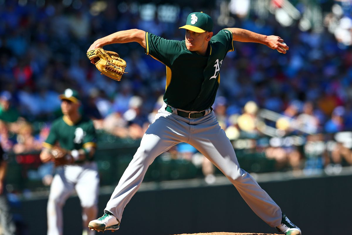 Pat Venditte, throwing left-handed for the Oakland Athletics.
