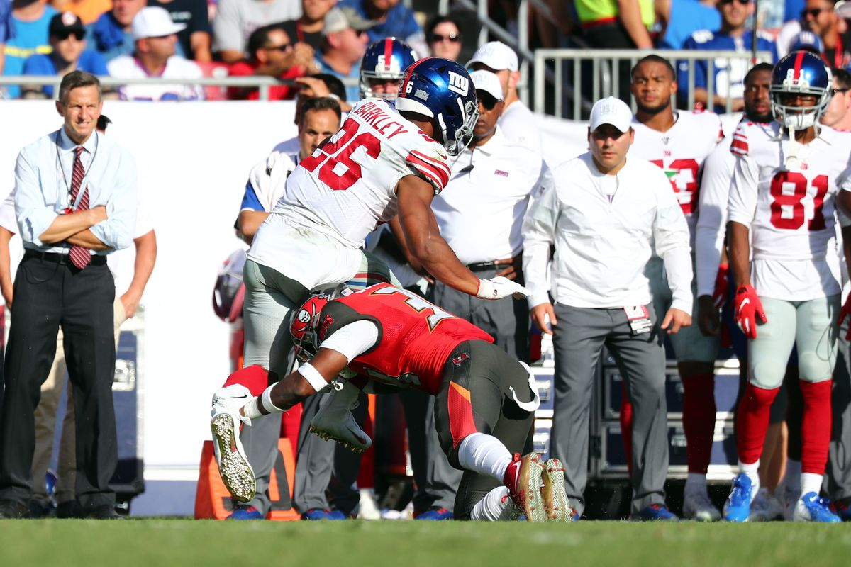 New York Giants running back Saquon Barkley is hit by Tampa Bay Buccaneers safety Mike Edwards before leaving the game with an apparent injury during the second quarter at Raymond James Stadium.