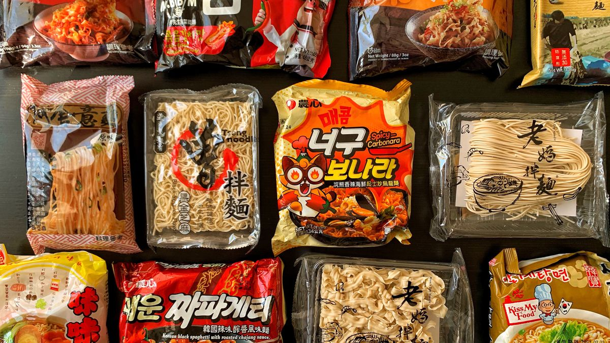 Multiple colorful packets of instant noodles.