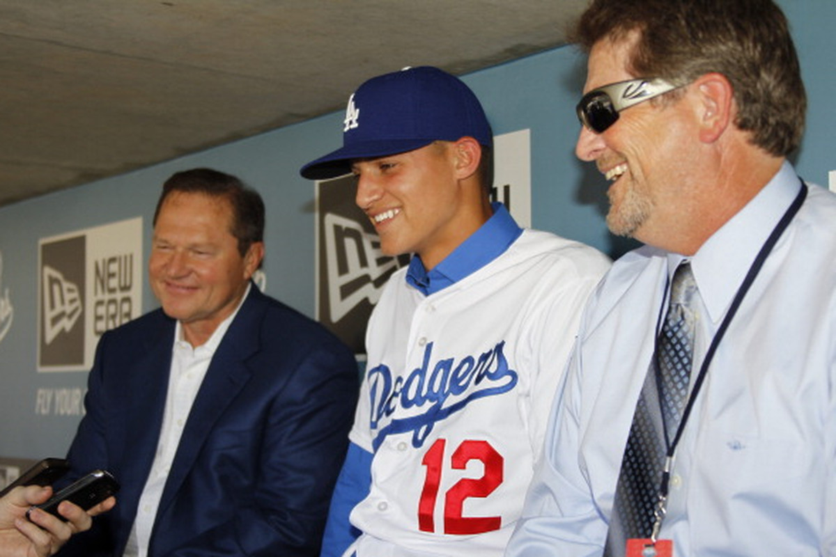 Scott Boras, Corey Seager, and Logan White are all very happy these days