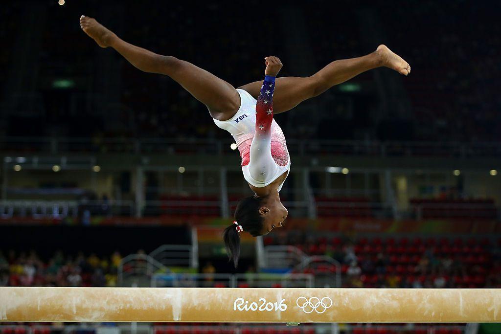 Simone Biles on the gymnastics Beam