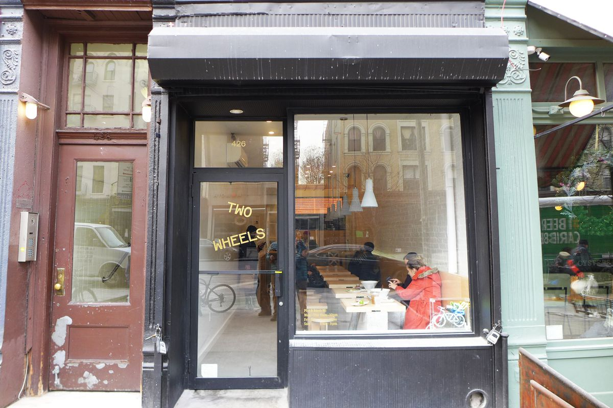 A very plain narrow storefront with almost no signage.