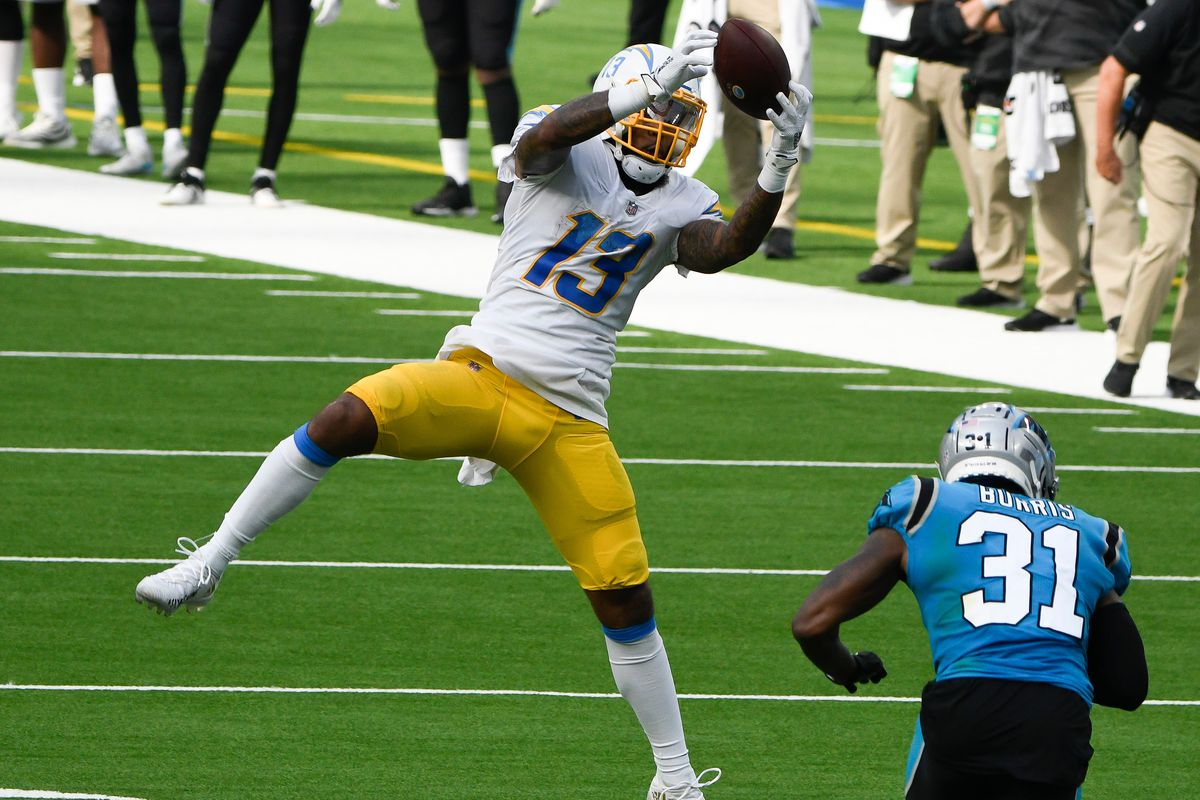 Los Angeles Chargers wide receiver Keenan Allen (13) makes a leaping catch in front of Carolina Panthers strong safety Juston Burris (31) during the third quarter at SoFi Stadium.