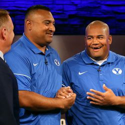 Kalani Sitake, head coach, and 'Ilaisa Tuiaki, BYU defensive coordinator and defensive line coach, shake hands during BYU Football Media Day at BYU Broadcasting in Provo on Friday, June 23, 2017.