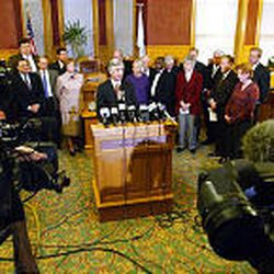 Salt Lake Mayor Rocky Anderson, flanked by religious and civic leaders, speaks to the media in December 2002 on a controversial issue.