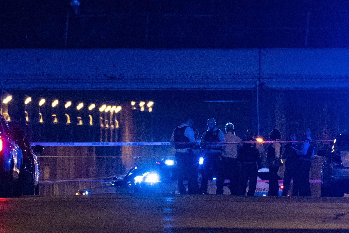 Chicago police work the scene where two police officers where shot during a traffic stop in the 6300 block of South Bell Avenue in West Englewood on Saturday, Aug. 7, 2021.