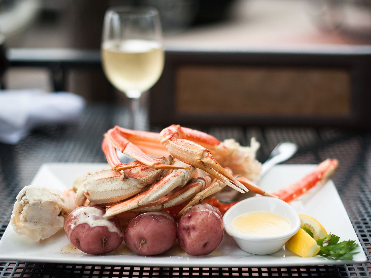 Crab legs over potatoes with white wine