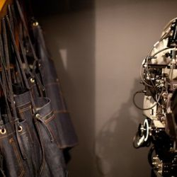 Levi's aprons next to a 35mm film camera at the Levi's Film Workshop at MOCA