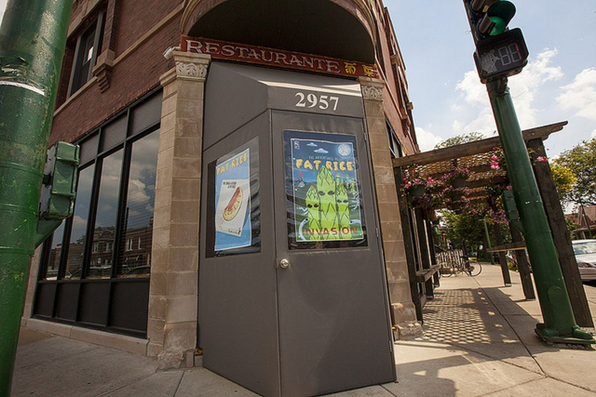 The exterior of a restaurant with a fabric vestibule.