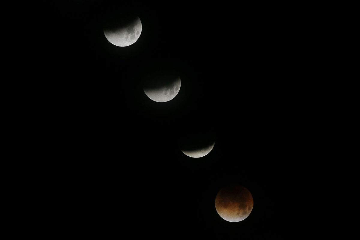 Composite of eight photos of a lunar eclipse as seen from Snow Canyon State Park in Washington County, Utah, on Wednesday, Jan. 31, 2018.