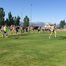 Olympian Ryan Hall takes a group of local runners through a series of exercises he does before a training run on Monday morning at South Field Park in Heber City. He and his father were in Utah for a vacation and agreed to meet with a handful of local runners and coaches.