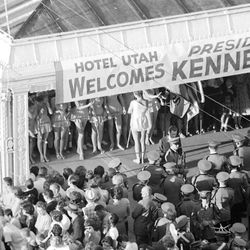 A local band and drill team await the arrival of the President at the Hotel Utah on Sept. 26, 1963. Deseret News Archives