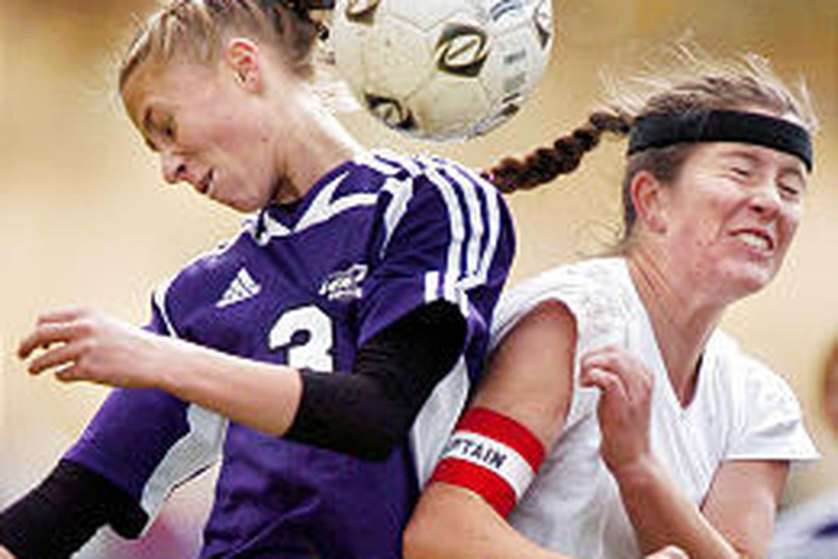 Lehi's Nicole Cardon (3) and Park City's Stevie Thurin (2) battle for the ball in 3A semifinal soccer action.
