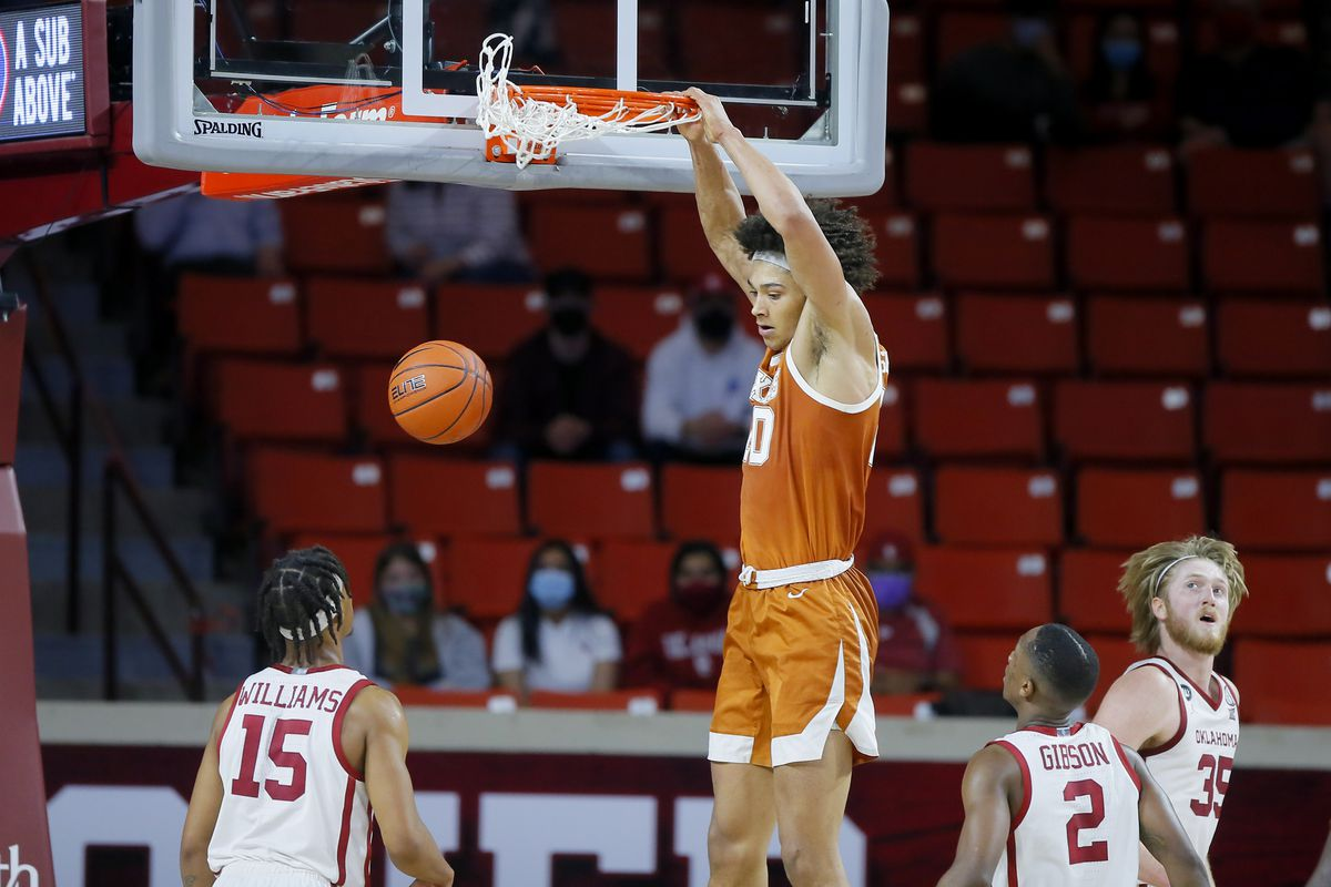 Texas' Jericho Sims (20) dunks the ball as Oklahoma's Alondes Williams (15), Umoja Gibson (2) and Brady Manek (35) watch during an NCAA college basketball game between the University of Oklahoma (OU) and the University of Texas (UT) at Lloyd Noble Center in Norman, Okla., Thursday, March 4, 2021. Texas won 69-65.