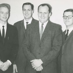 Former BYU football coach LaVell Edwards, second from right.