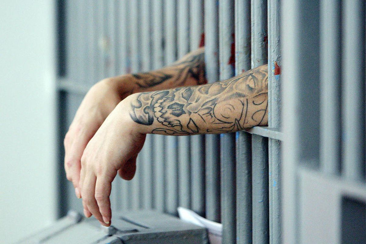 An inmate hangs his hands outside the bars at the  Utah State Prison  Wednesday, Feb. 6, 2013.
