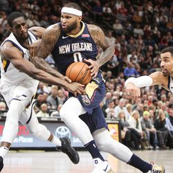 New Orleans Pelicans center DeMarcus Cousins (0) drives the key while Utah Jazz center Ekpe Udoh (33) reaches in as Utah hosts New Orleans at Vivint Arena in Salt Lake on Friday, Dec. 1, 2017.