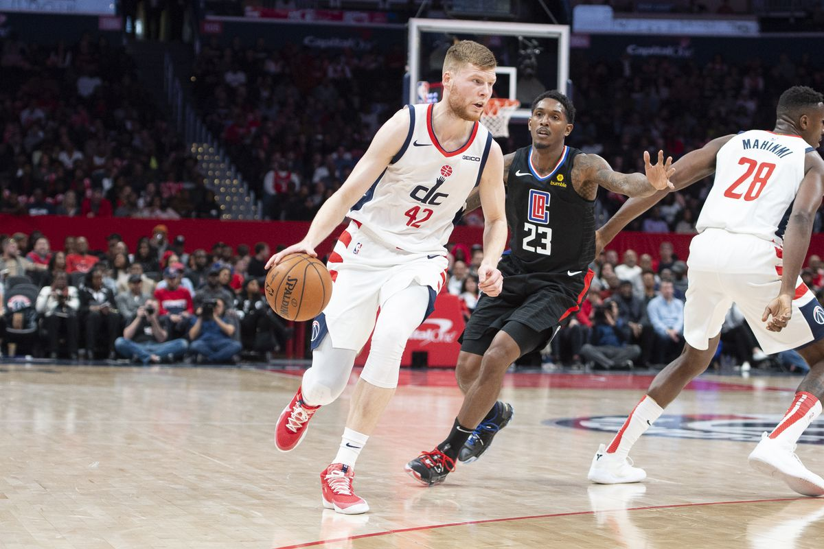 Washington Wizards forward Davis Bertans dribbles as Los Angeles Clippers guard Lou Williams defends dubbing the second half at Capital One Arena.