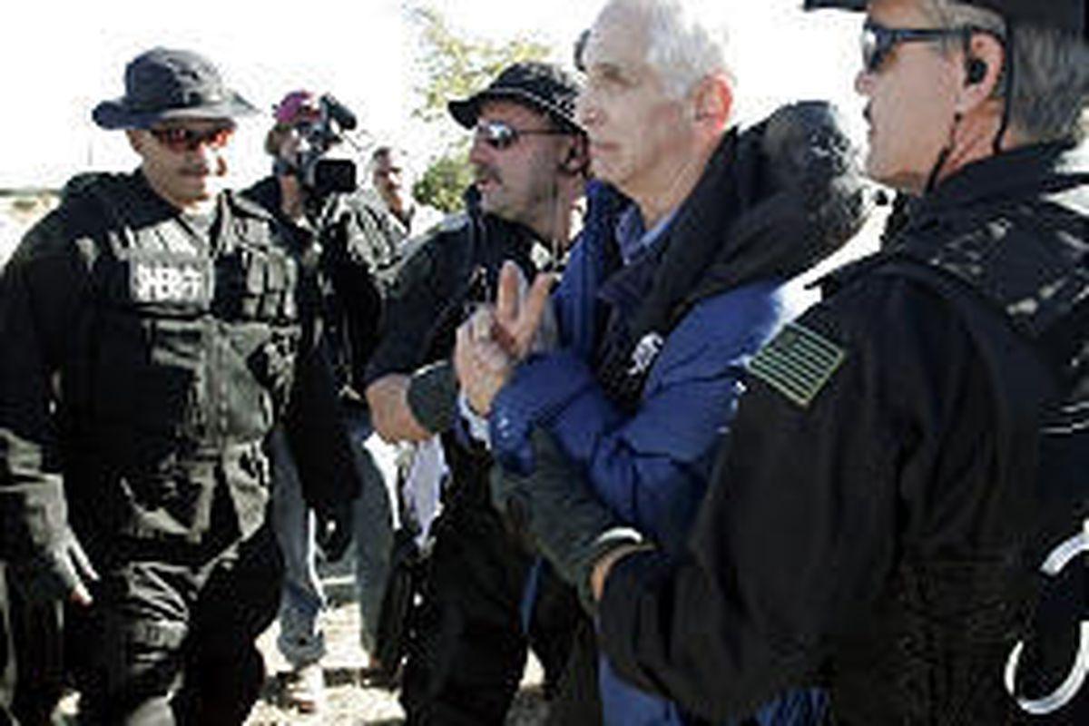 Anti-war activist Daniel Ellsberg is arrested Wednesday by McLennan sheriff's deputies near President Bush's ranch in Crawford, Texas.