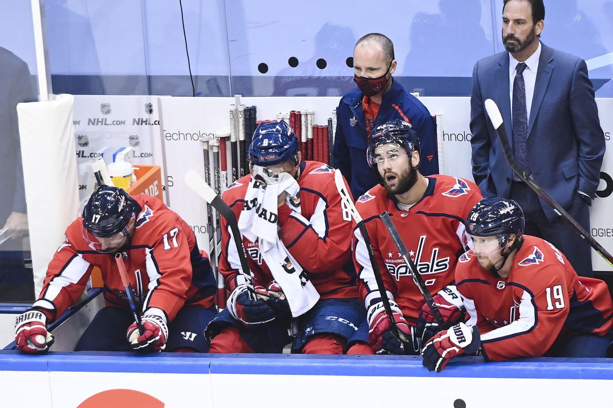 Washington Capitals players watch the closing moments of their playoff game against the New York Islanders.