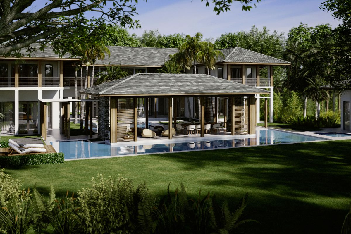 Backyard view of a modern home in Gables estates. Lush. Infinity pool.