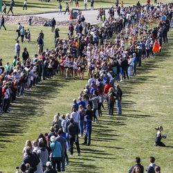 Spectators line the race course to cheer on runners during the 4A Girls State Cross-Country Championships at Sugar House Park in Salt Lake City on Wednesday, Oct. 23, 2019.
