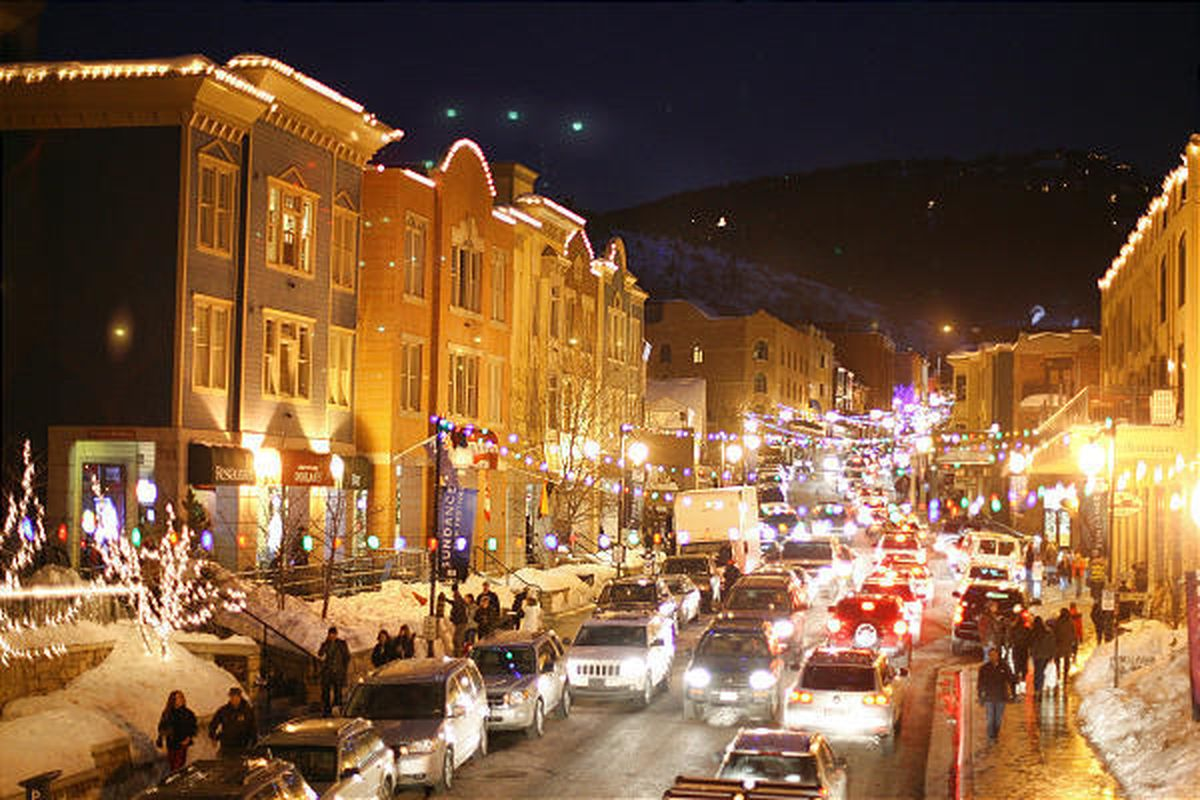 People and cars crowd Main Street in Park City during the 2008 Sundance Film Festival. Park City boasts a population of 6,500.