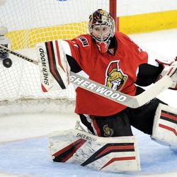 Ottawa Senators' Craig Anderson deflects a shot as he takes on the New York Rangers during the first period of game three of first round NHL Stanley Cup playoff hockey action at the Scotiabank Place in Ottawa on Monday, April 16, 2012. (AP Photo/The Canadian Press, Sean Kilpatrick)