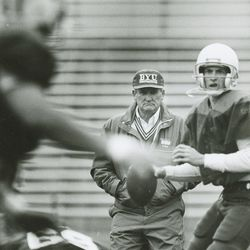 BYU head football coach LaVell Edwards watches Tom Young throw on March 24, 1991.