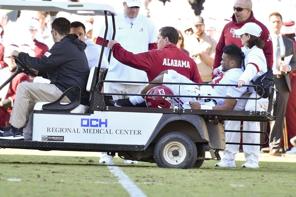 Alabama Crimson Tide quarterback Tua Tagovailoa is carted off the field due to an injury during the second quarter of the game against the Mississippi State Bulldogs at Davis Wade Stadium.