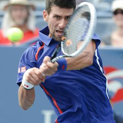 Novak Djokovic of Serbia returns a shot to Switzerland's Stanislas Wawrinka in the fourth round of play at the 2012 US Open tennis tournament,  Wednesday, Sept. 5, 2012, in New York. (AP Photo/Henny Ray Abrams)