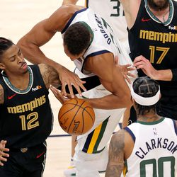 Memphis Grizzlies guard Ja Morant (12) knocks the ball away from Utah Jazz center Rudy Gobert (27) as the Utah Jazz and the Memphis Grizzlies play in game one of their NBA playoff series at Vivint Arena in Salt Lake City on Sunday, May 23, 2021. Memphis won 112-109.