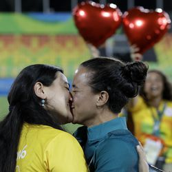 Brazil's rugby player Isadora Cerullo, right, kissed her partner Marjorie Enya, after getting engaged at the end of the medal ceremony for the women's rugby sevens match at the Summer Olympics in Rio de Janeiro, Brazil, Monday, Aug. 8, 2016.