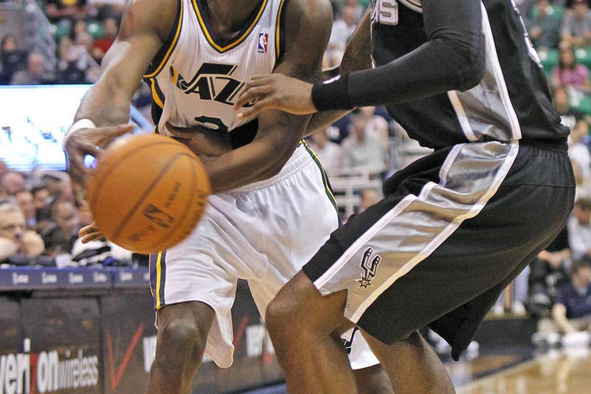 Utah's DeMarre Carroll passes as Spur's Stephen Jackson defends as the Utah Jazz and the San Antonio Spurs play NBA basketball Monday, April 9, 2012, in Salt Lake City, Utah.
