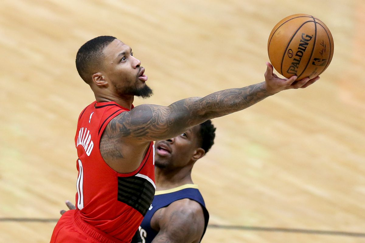 Damian Lillard of the Portland Trail Blazers shoots over Eric Bledsoe of the New Orleans Pelicans during the second quarter of an NBA game at Smoothie King Center on February 17, 2021 in New Orleans, Louisiana.
