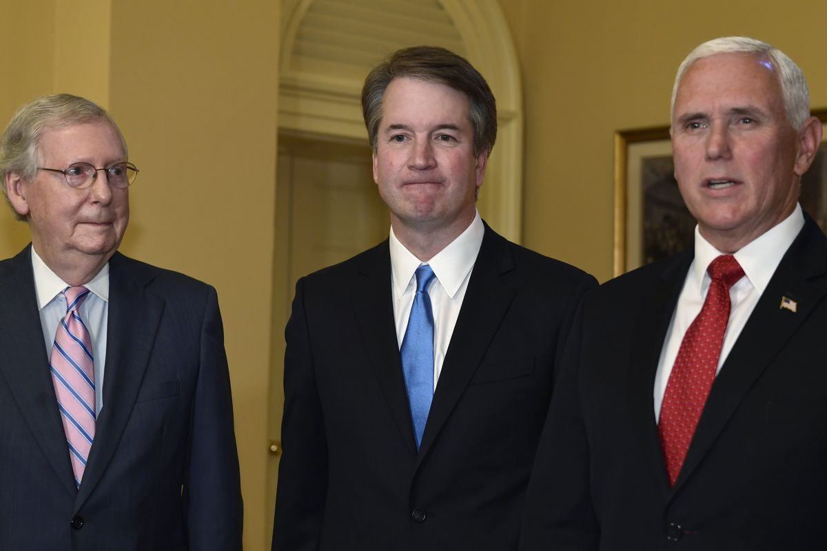 Vice President Mike Pence, right, speaks about Supreme Court nominee Brett Kavanaugh, center, as Senate Majority Leader Mitch McConnell of Ky., left, listens during a visit to Capitol Hill in Washington, Tuesday, July 10, 2018. Kavanaugh is on Capitol Hil