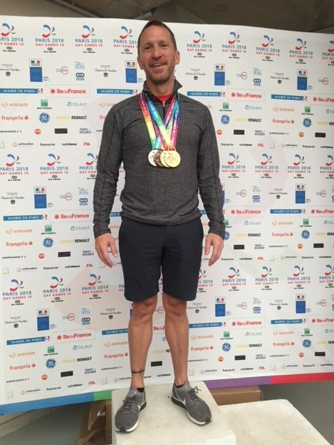 Matthew Kinney with his medals at the 2018 Gay Games in Paris.