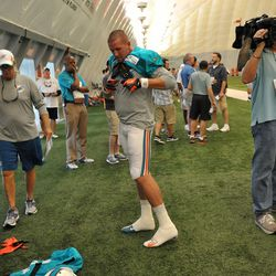 Jul 24, 2013; Davie, FL, USA; Miami Dolphins wide receiver Brian Hartline (82) makes adjustment's during training camp practice at the Doctors Hospital Training Facility at Nova Southeastern University.