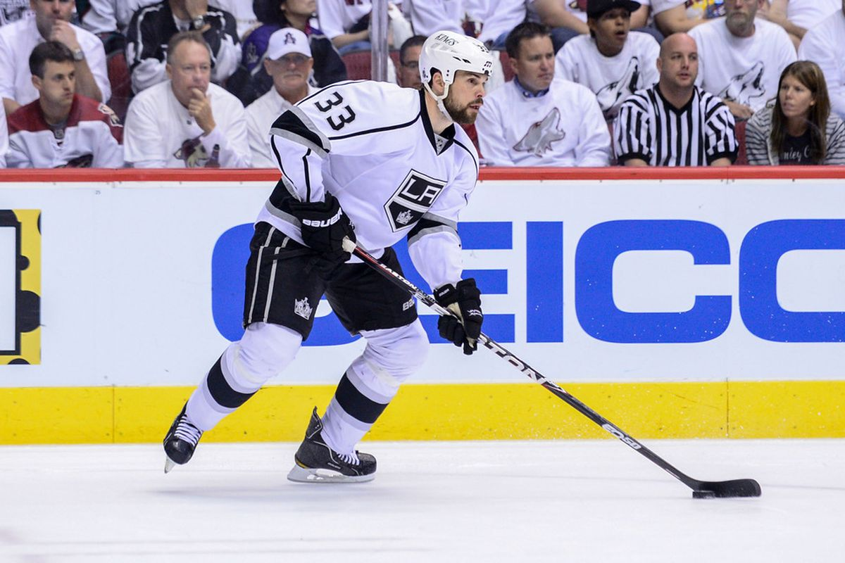May 15, 2012; Glendale, AZ, USA; Los Angeles Kings defenseman Willie Mitchell (33) carries the puck during game two of the Western Conference finals of the 2012 Stanley Cup Playoffs at Jobing.com Arena.  Mandatory Credit: Matt Kartozian-US PRESSWIRE